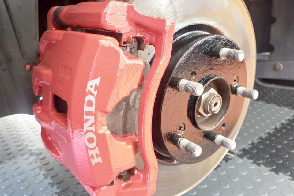 A painted Honda calliper