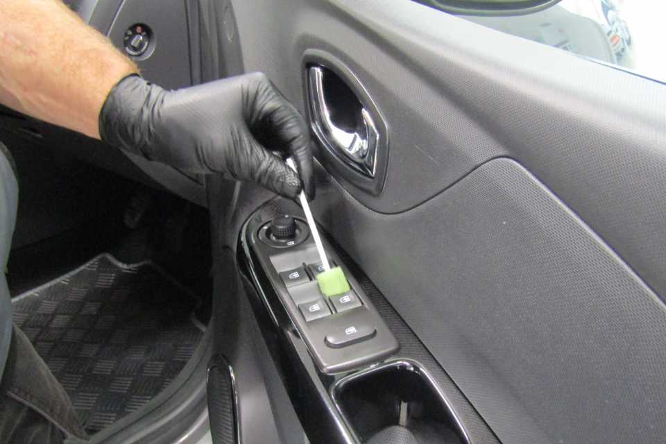 The window switch controls of a car being cleaned with high detail