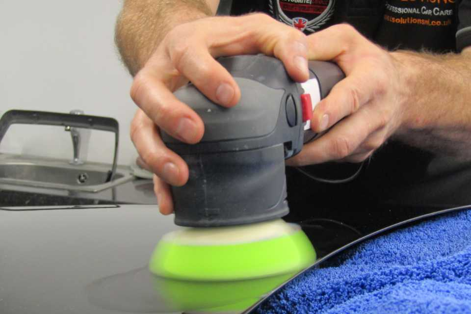 A buffing machine during a paint correction