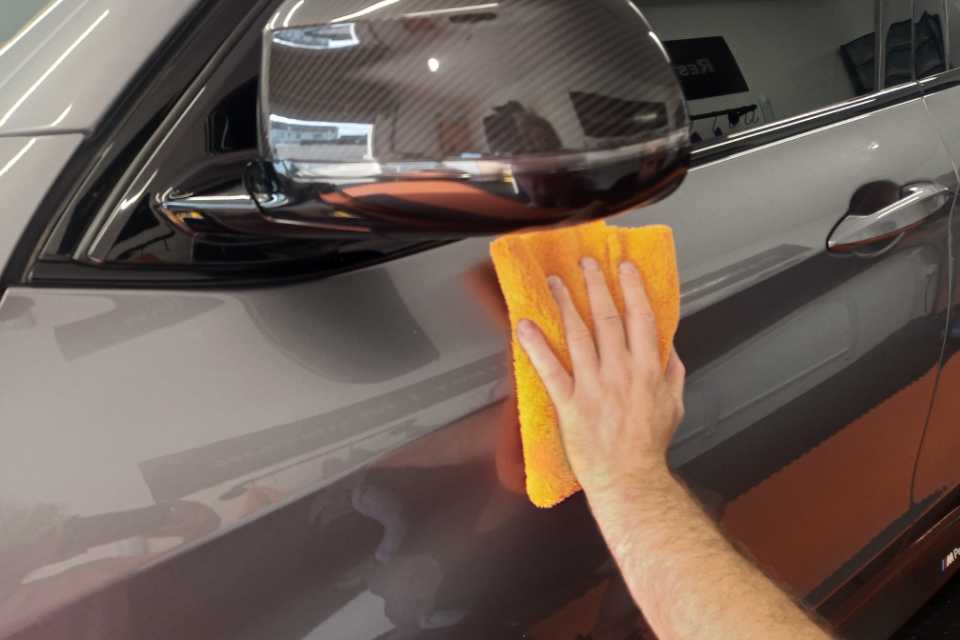 A detailing cloth on a cars paintwork