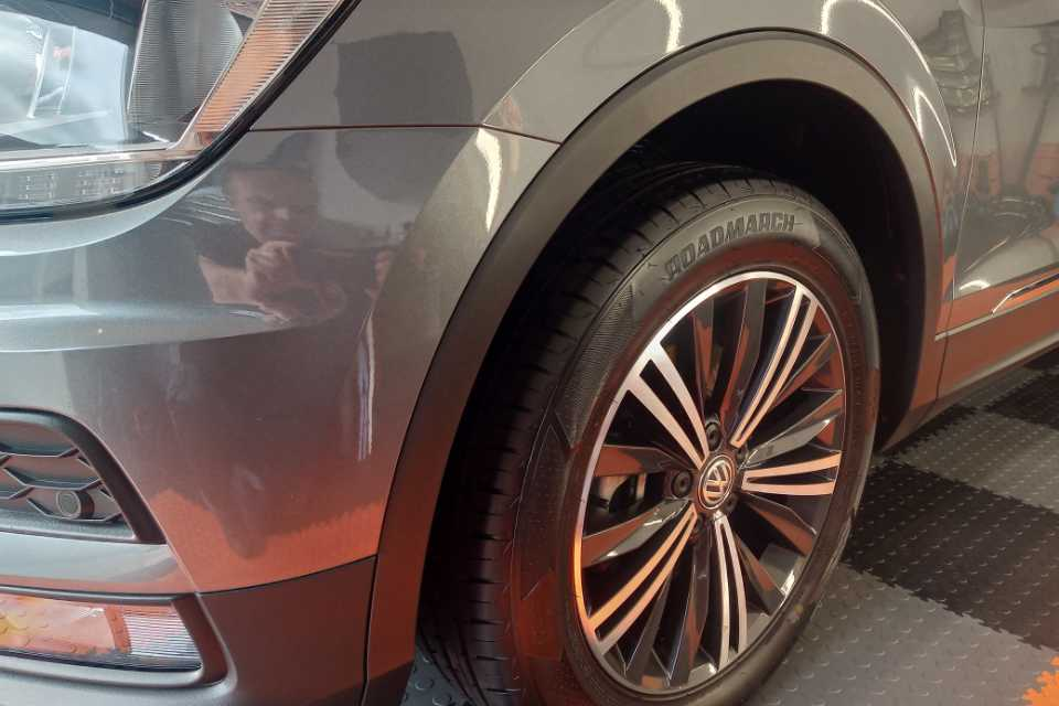 Shows a Volkswagen car wheel arch after a detail