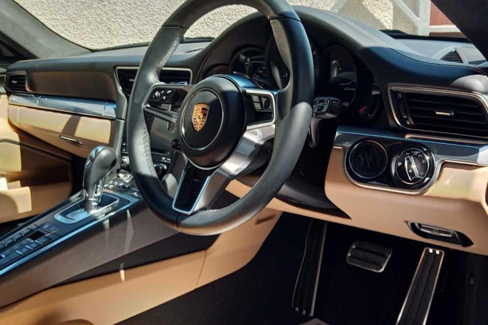Valeted Porsche interior showing steering wheel