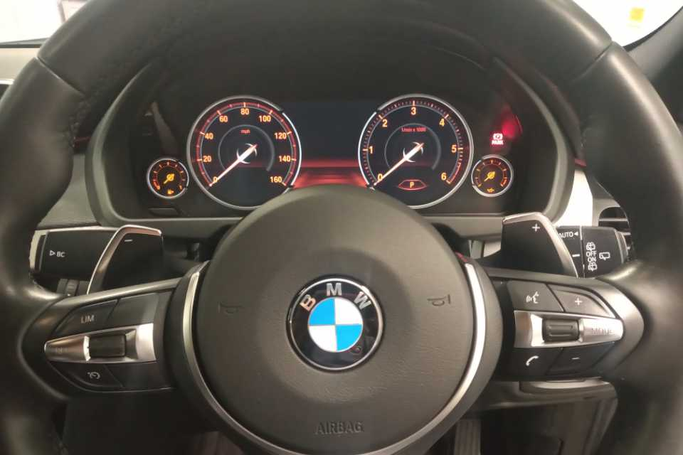 Valeted BMW steering wheel and instrument cluster