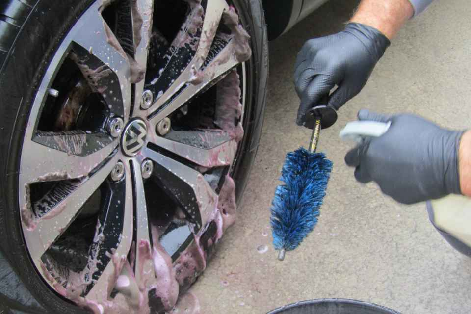 A car wheel being cleaned using ph neutral product