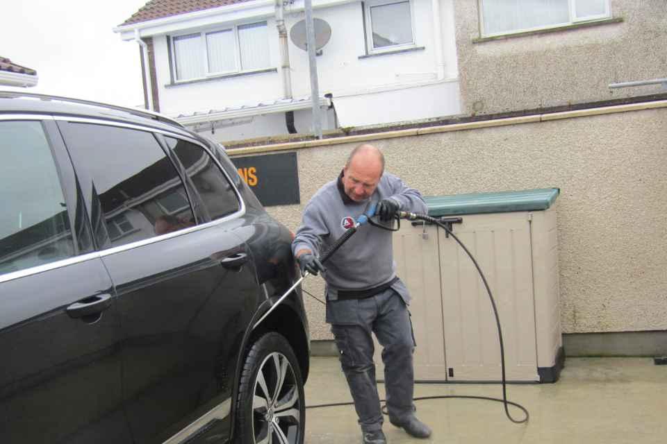Colin performing a car wash