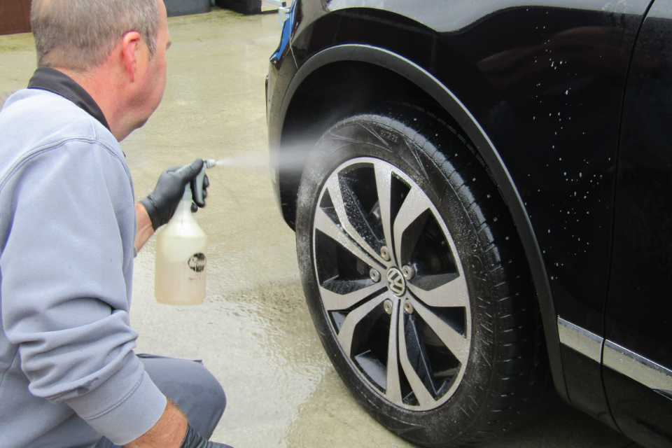 Colin performing a wheel arch clean